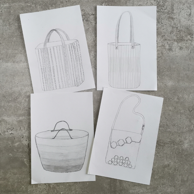 Flat lay of four bag pencilled bag sketches, each on it's own piece of A5 paper.