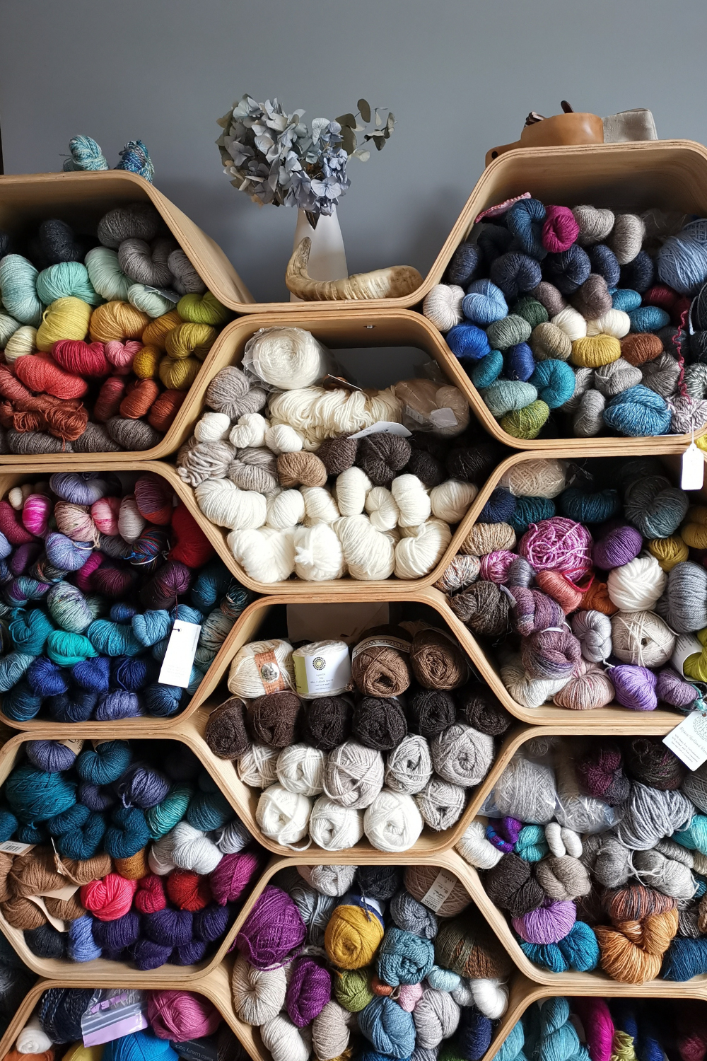 a close up of my honeycomb shelves that are now filled with my yarn stash.  Lots of colourful skeins and lots of batural sheep colours.