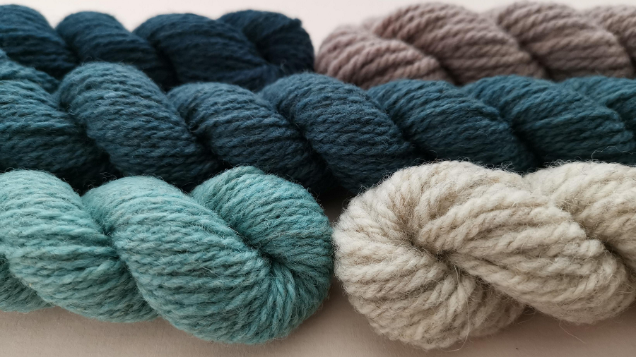 Mini skeins in shades of teal and neutrals. Some are 4 ply and some are chunky weight.  They all look properly woolly.