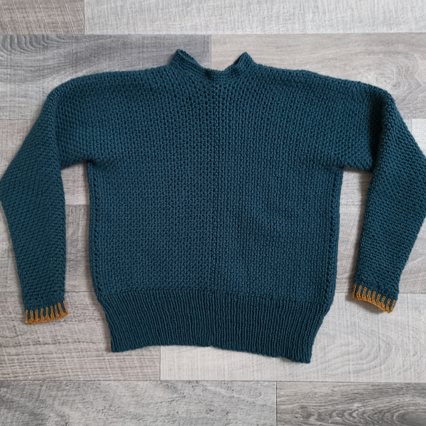 Flat lay of my dark teal Color Pop Sweater