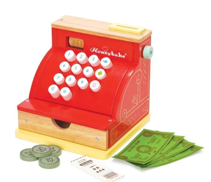 Caisse enregistreuse avec monnaie pièces et billets