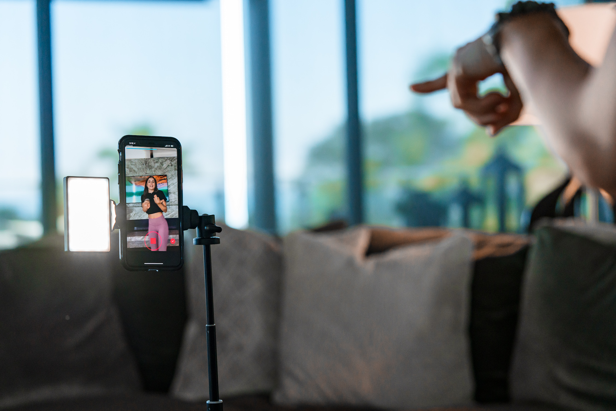 girl recording tiktok using the mobile creator kit xl