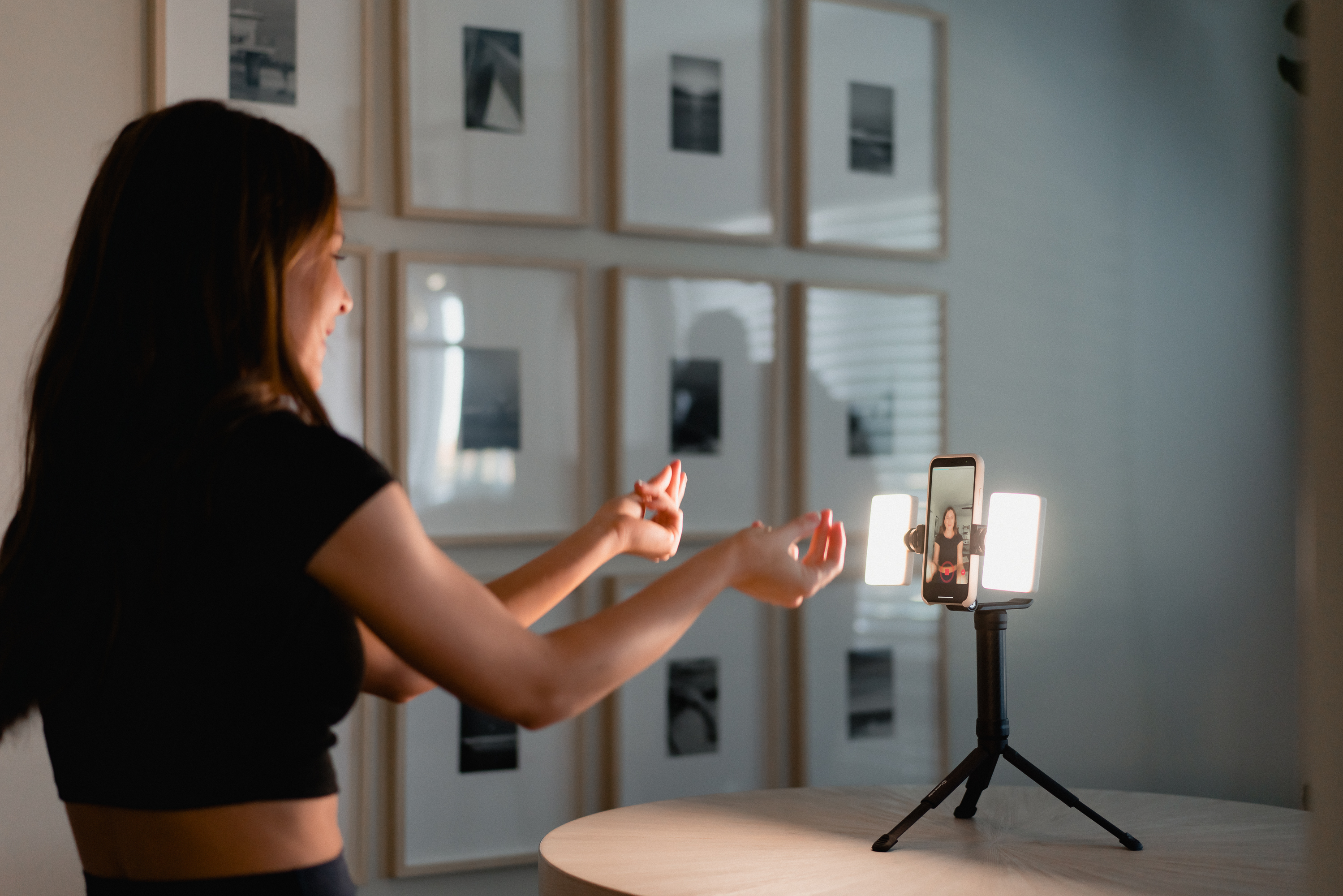 girl dancing with mobile creator kit placed on table