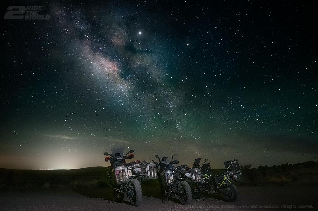 three dirt bikes shot at night