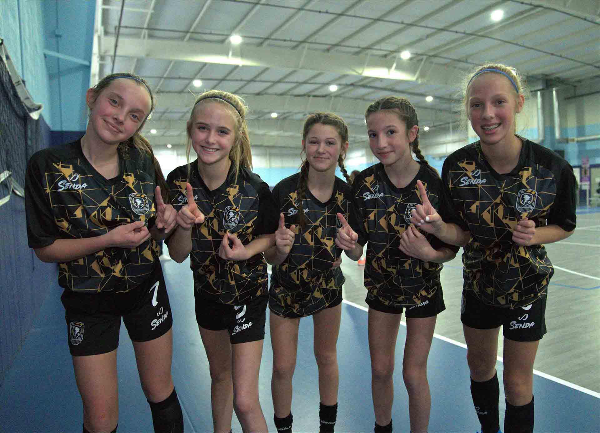 Sudamerica Futsal girls team with Senda customized home uniform