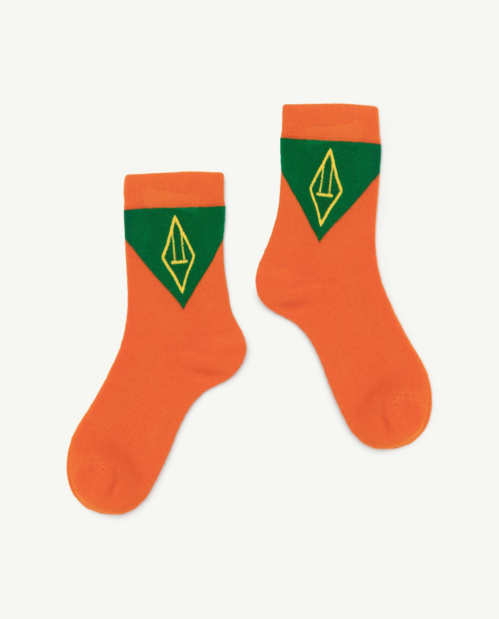 the animals observatory skunk socks orange logo