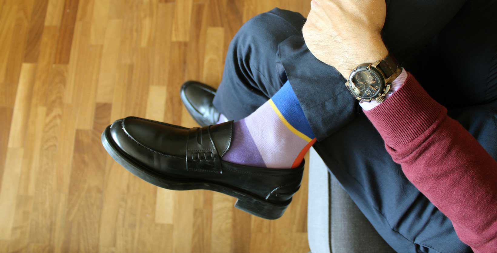 Pairing suit accessories like watch, socks, and shoes to outfit