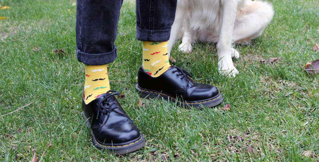 Man wearing funky socks and stylish shoes