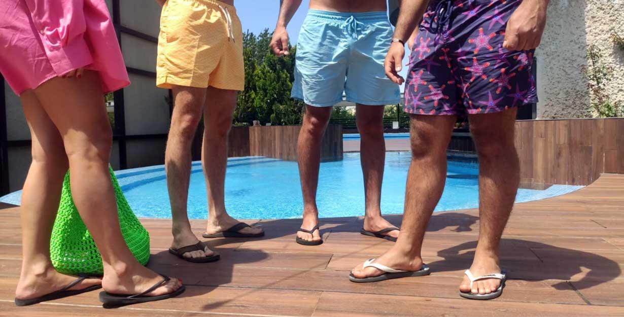 Wearing men's sandals at beach