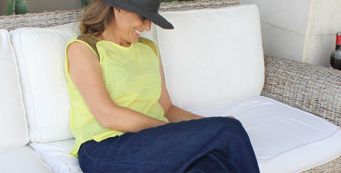 Woman wearing bold colors and hat