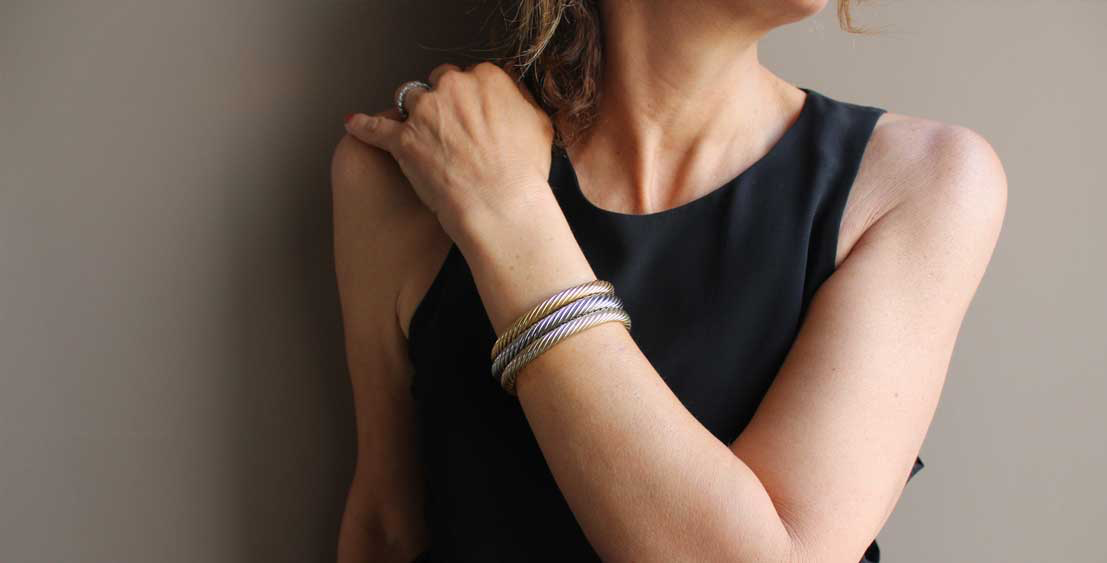 Woman wearing ring and bracelets that match skin undertone