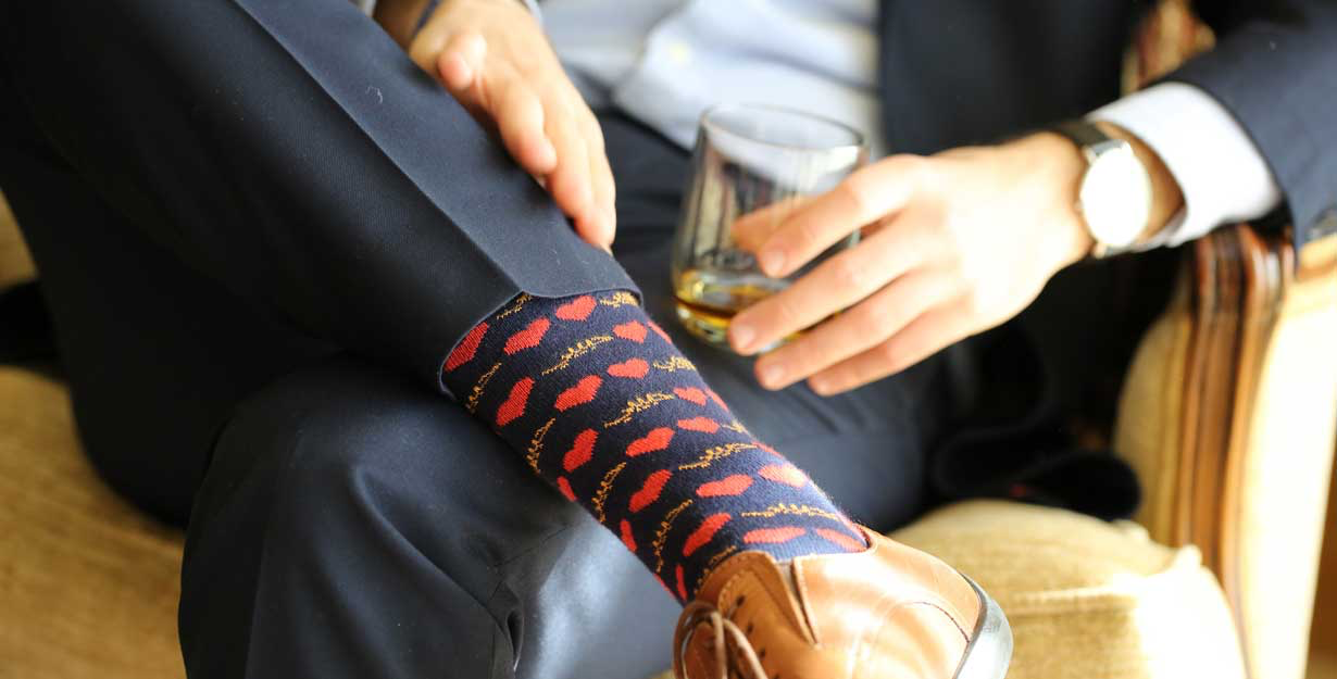 Watch and socks pairing to a suit