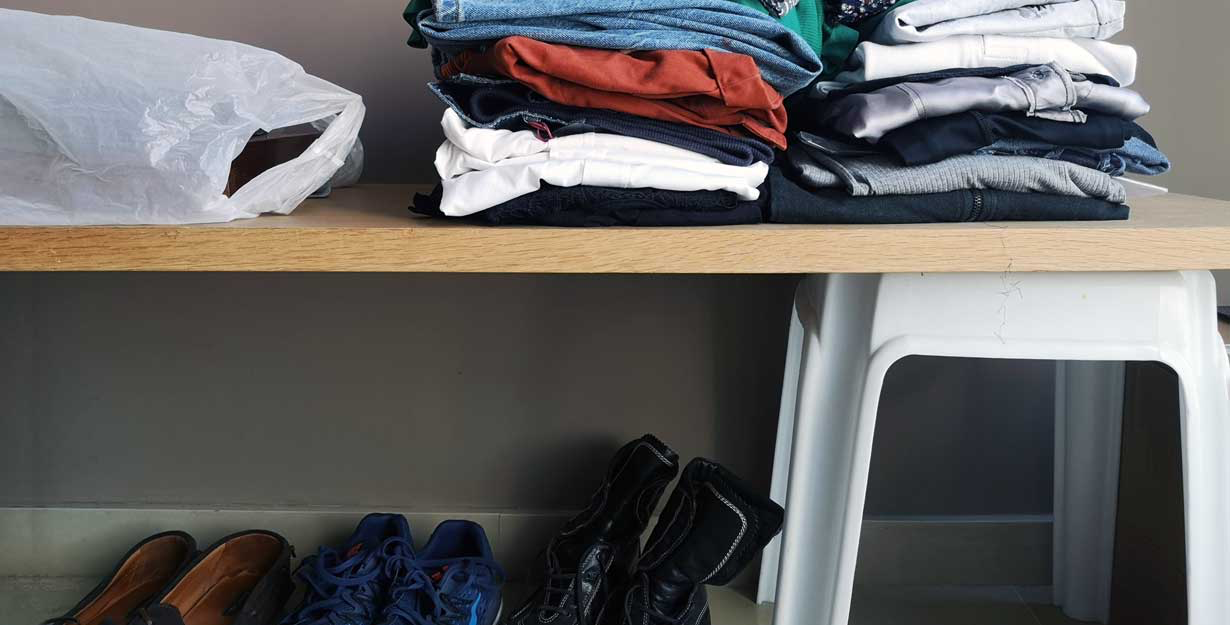 Closet filled with clothes for donations