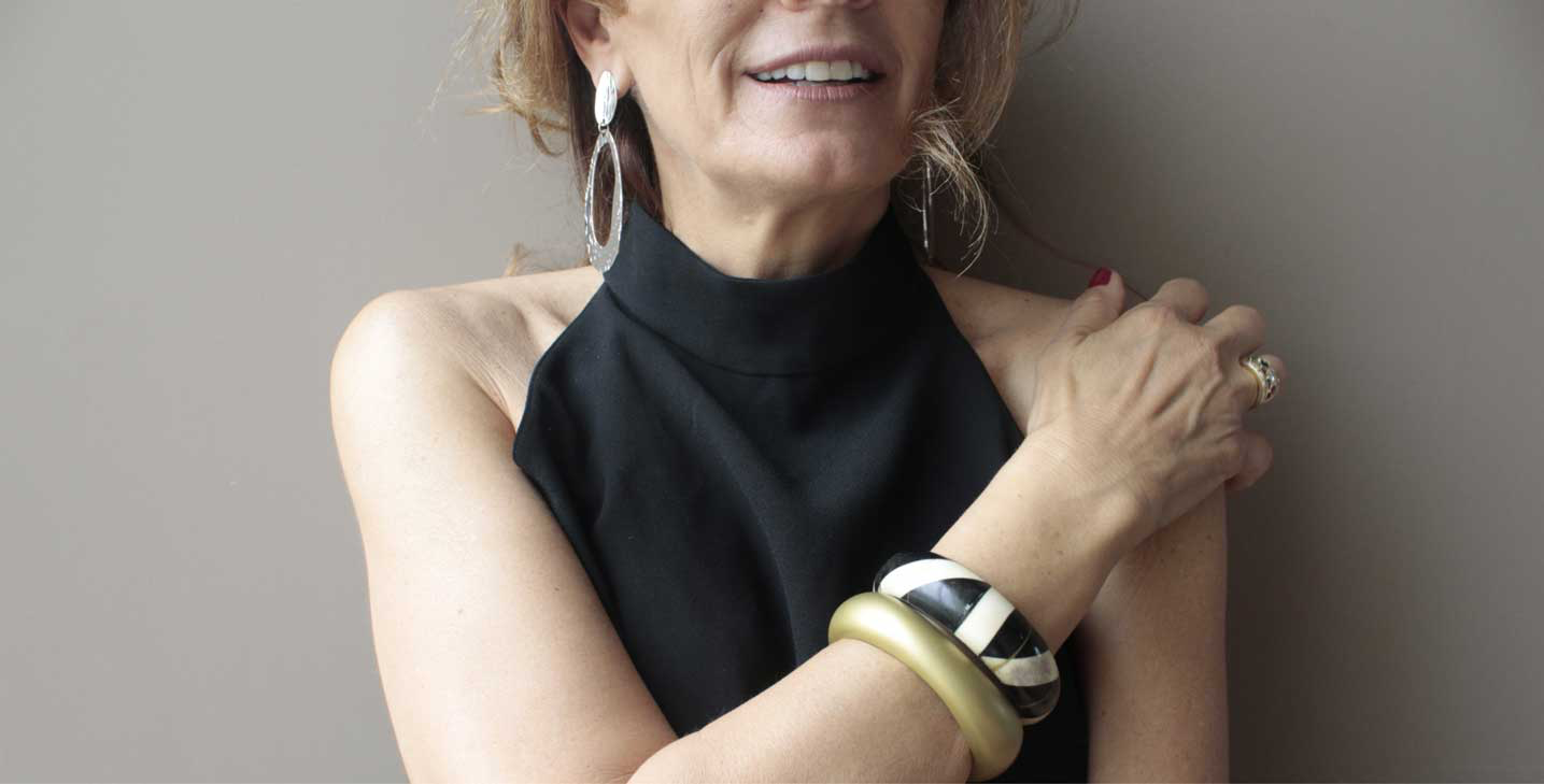 Woman wearing bracelets and earrings