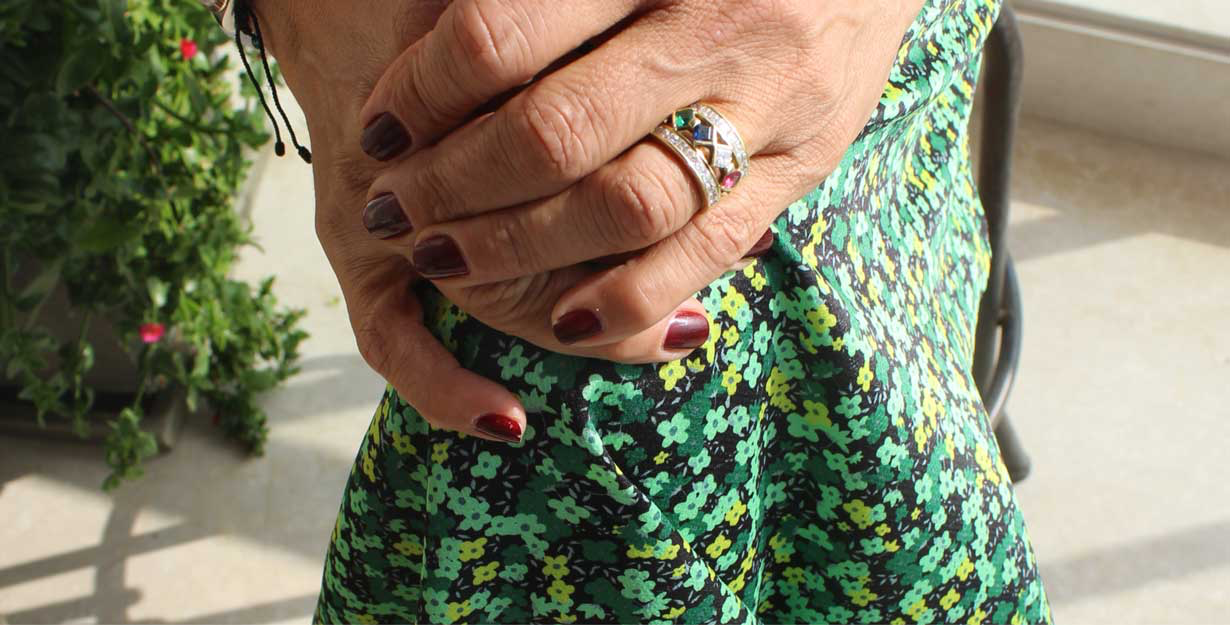Woman wearing a ring and colorful dress
