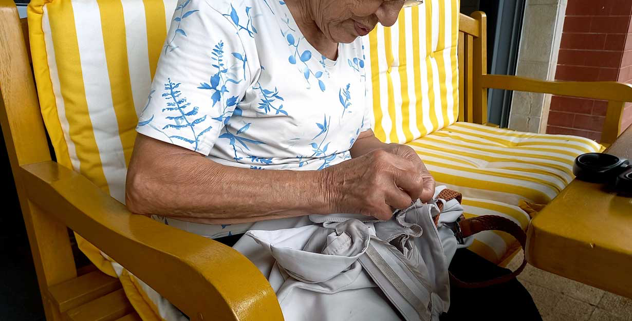 Woman tailoring clothes