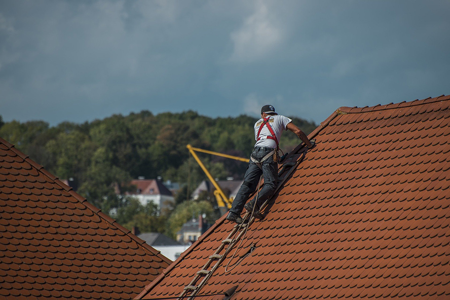 A roofing contractor working on a roof.