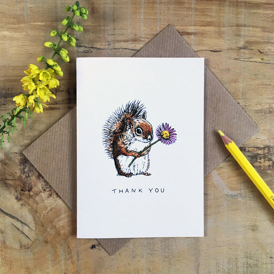 A thank you card featuring an illustration of a squirrel holding a flower.