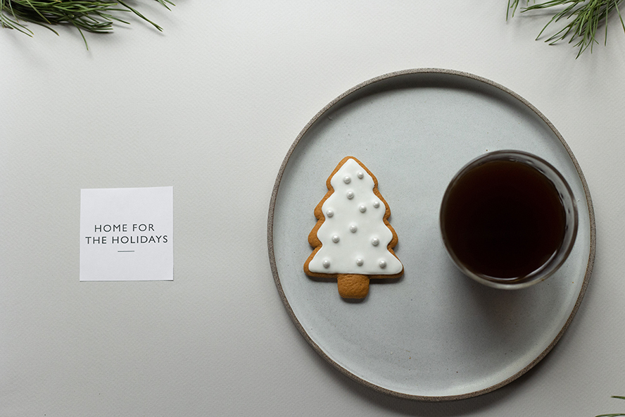 A Christmas tree cookie, some tea, and a holiday card.