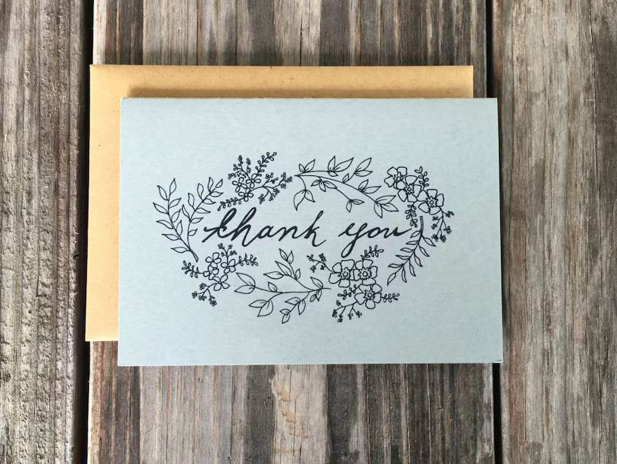 A line art floral patterned thank you card.