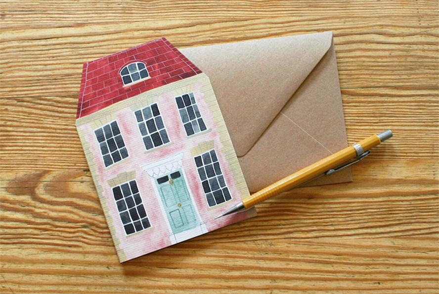 A card shaped like a house.