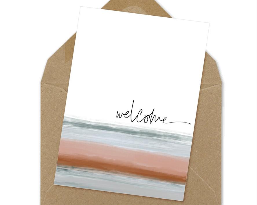 A handwritten welcome card.