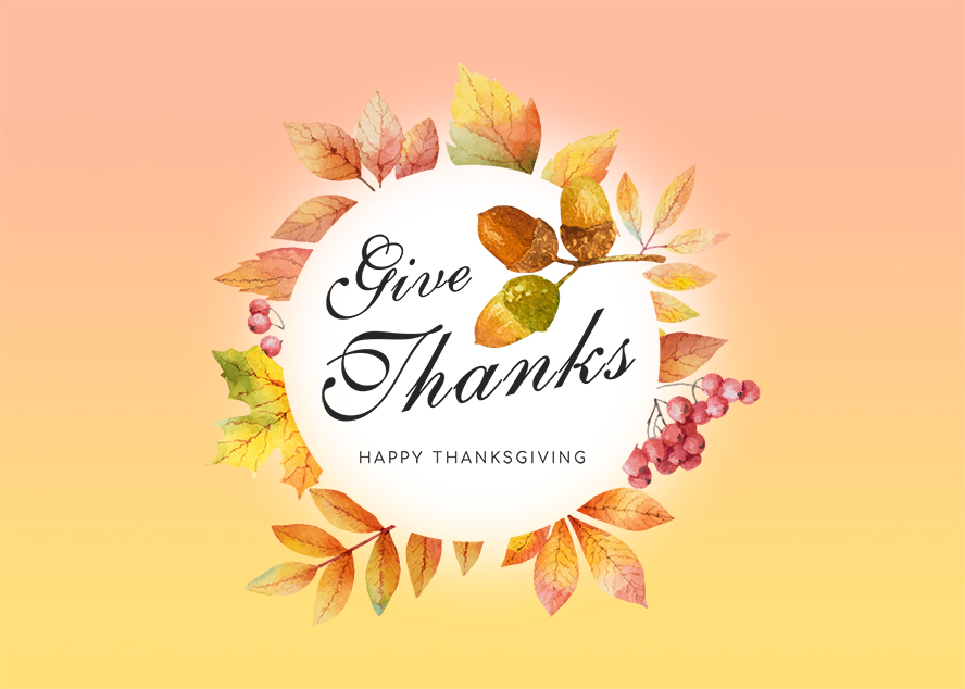 A ring of leaves and berries surround a Thanksgiving message on this card.
