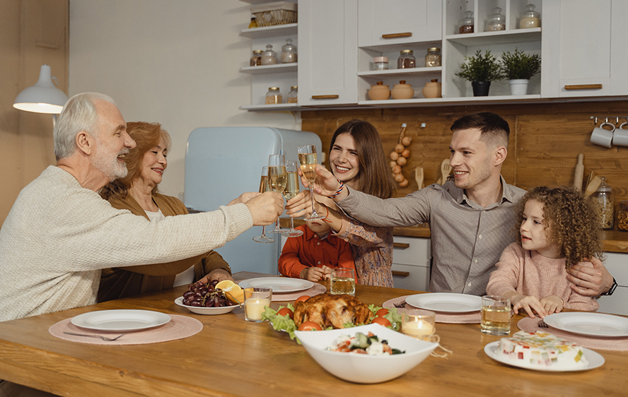 Family toasting champagne over a Thanksgiving meal.