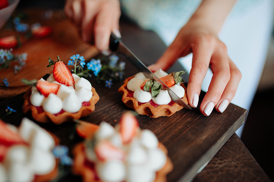 Close up on a woman's hands preparing dessert.