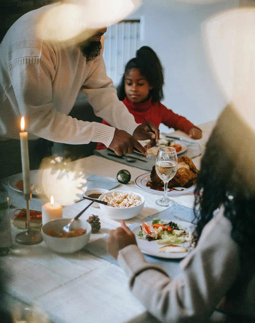 A second family sits down to a Thanksgiving meal.