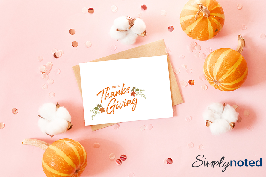 A happy Thanksgiving card surrounded by gourds.