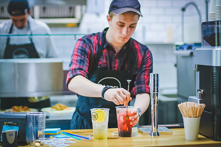 A food service employee working.