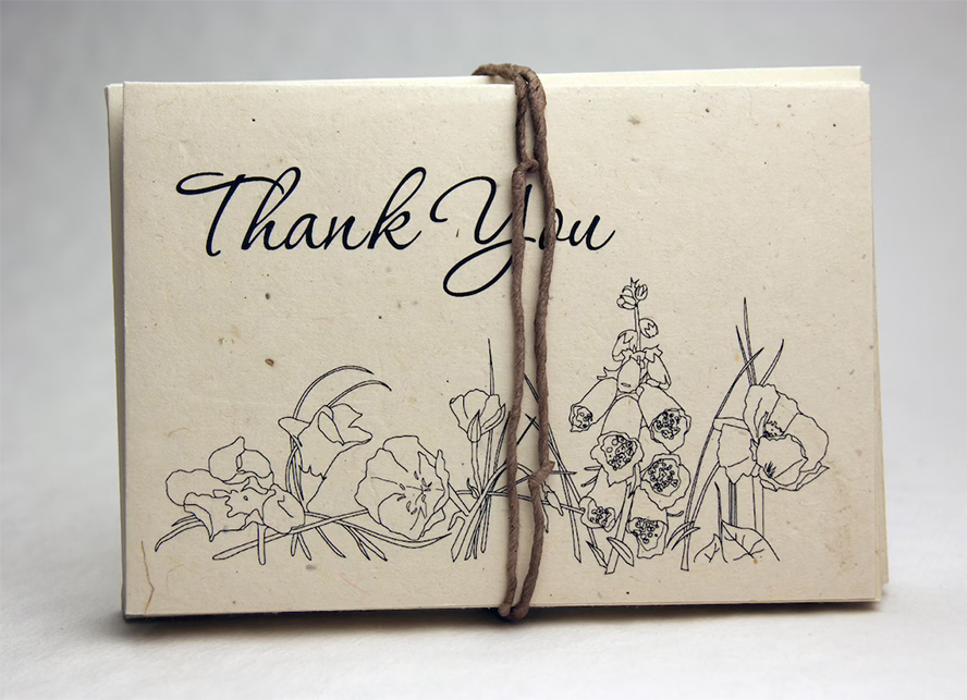A bundle of thank you cards with illustrated flowers.