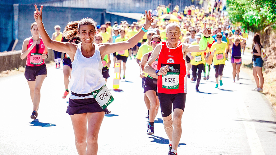 A local running event, runners waving to the camera.
