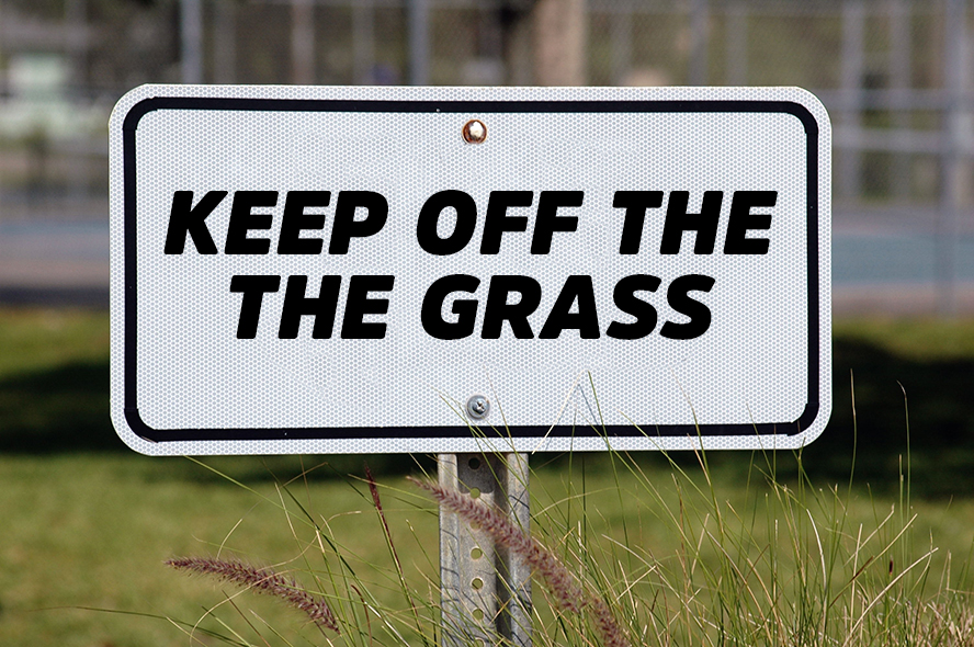"Sign that says, ""Keep off the grass"""