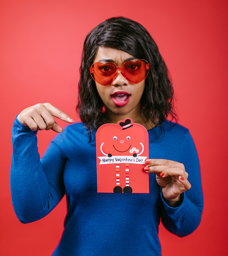 Happy woman shows off a Valentine's Day card.