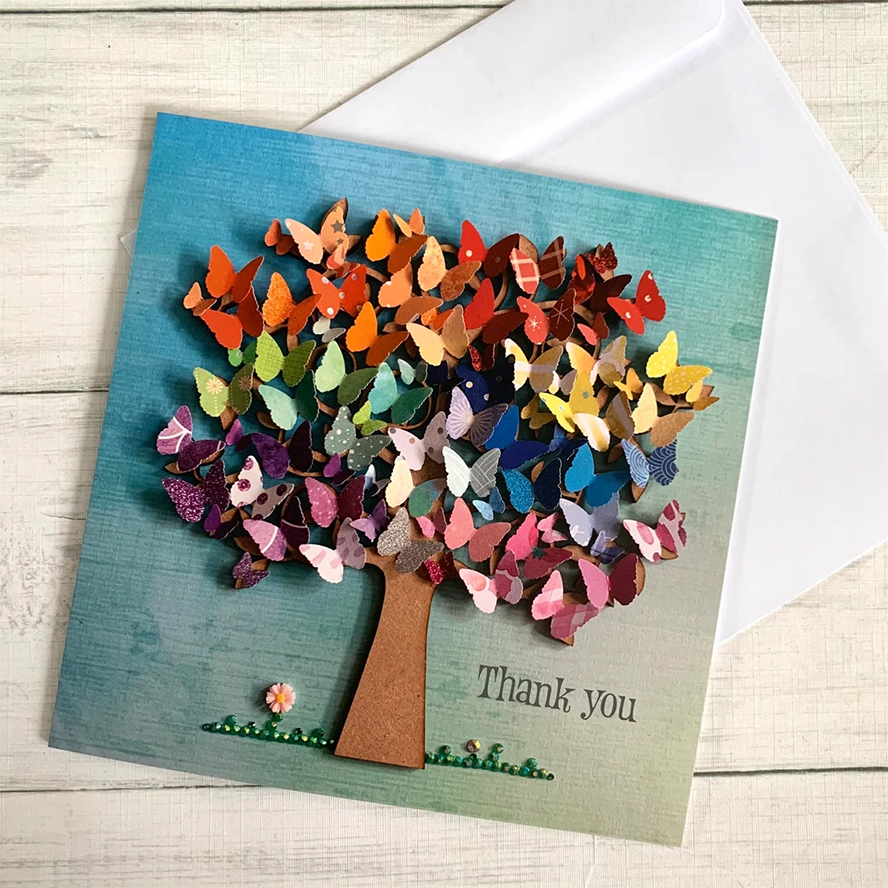 A thank you card that features a tree with butterfly flowers.