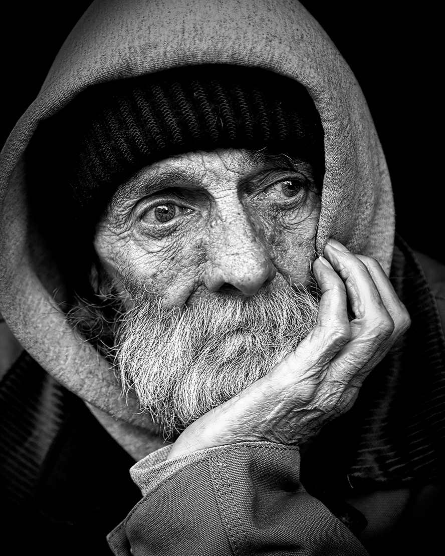 A black and white photo of a homeless man