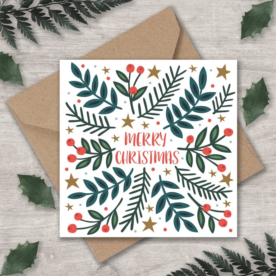A Christmas card with holly berries and stars.