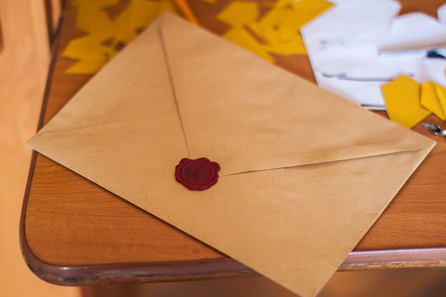 A fancy envelope with a wax seal.