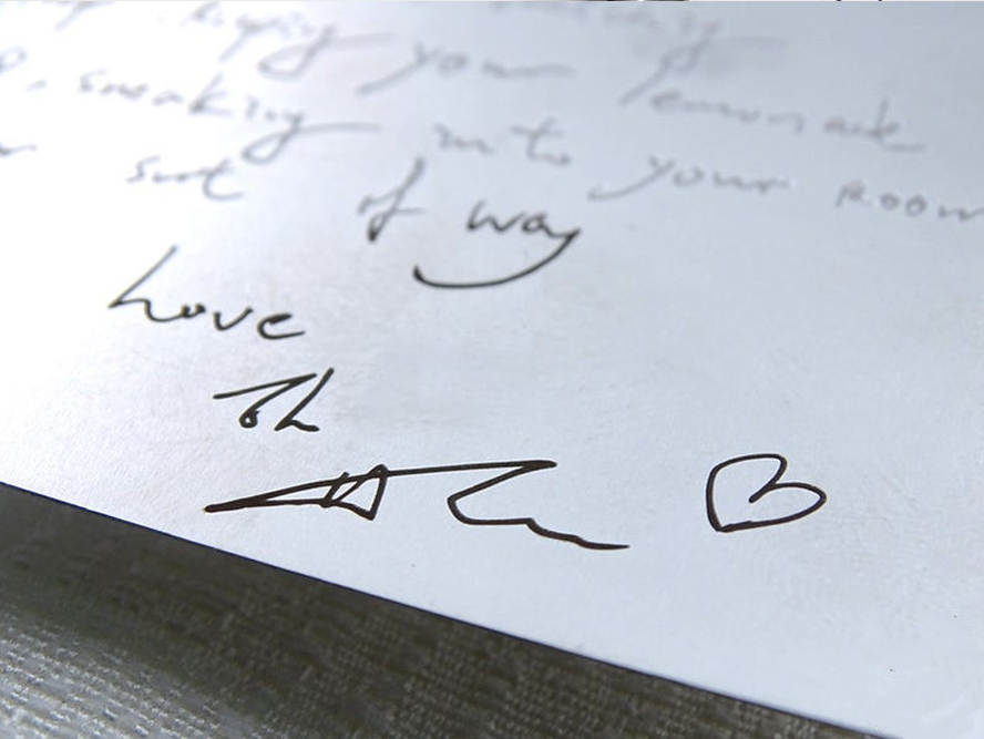 A close up of someone's handwriting in a card.