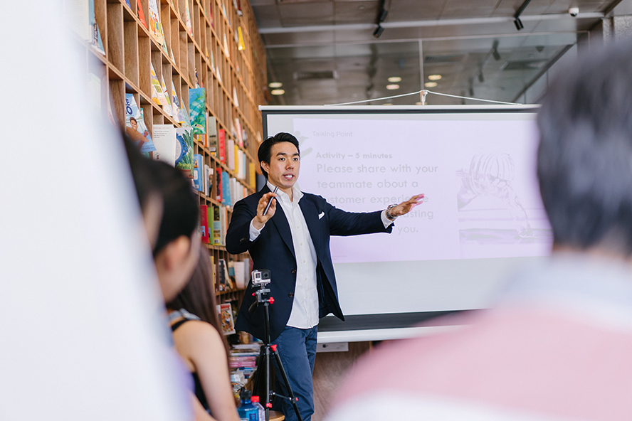 A man making a business presentation to a group of people.