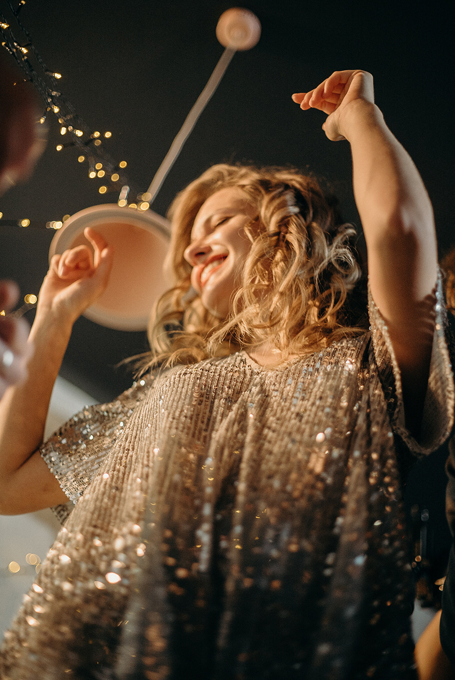 A woman dancing at a holiday party.