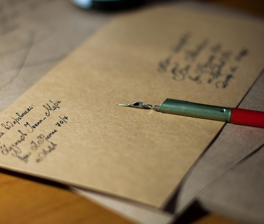 Handwritten envelope and pen