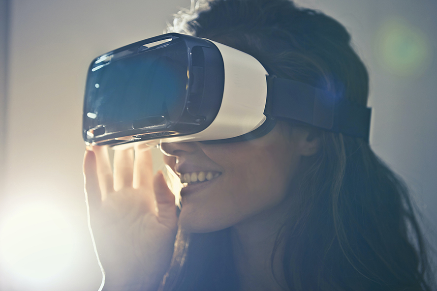 A woman wearing VR goggles.