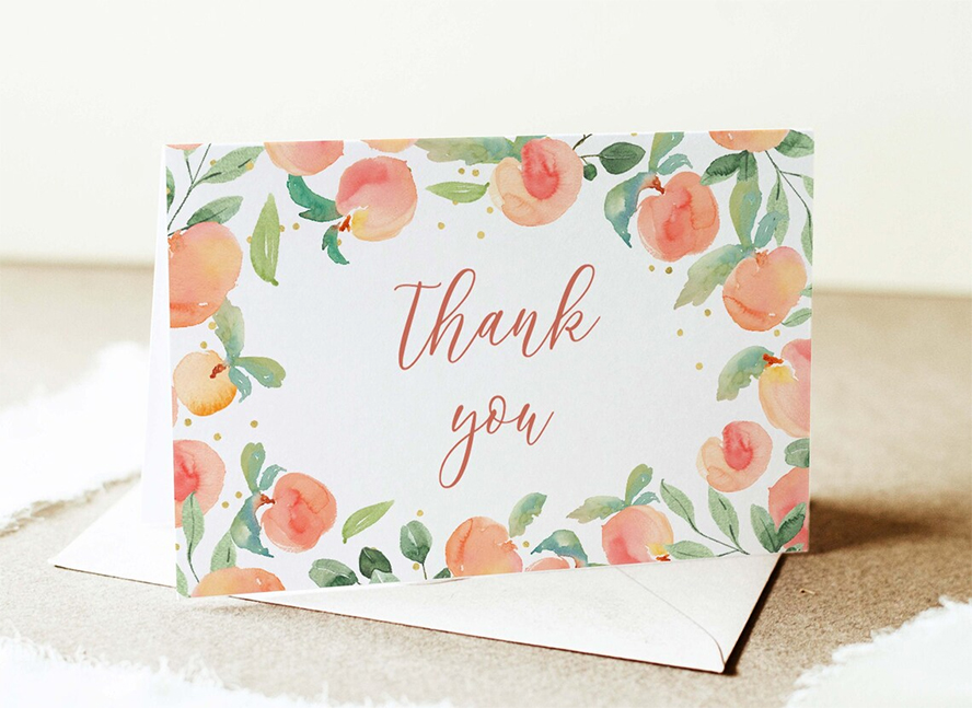 A thank you card rimmed with illustrated peaches.