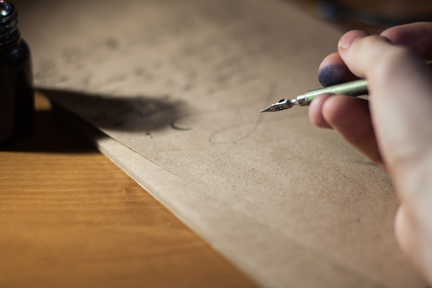 Close up of someone handwriting a letter.