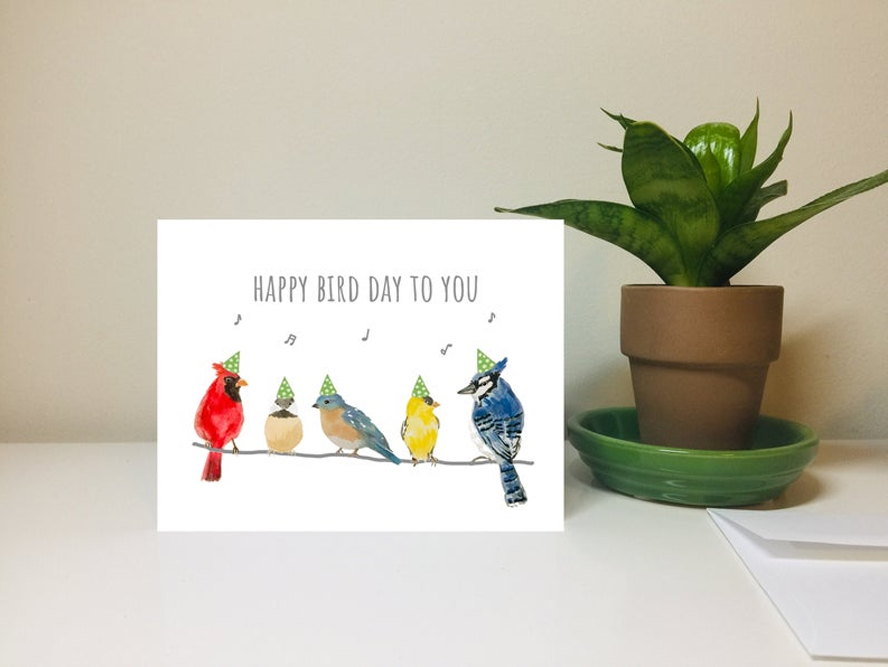"A birthday card that says ""Happy Bird Day to You"" and features pictures of birds."