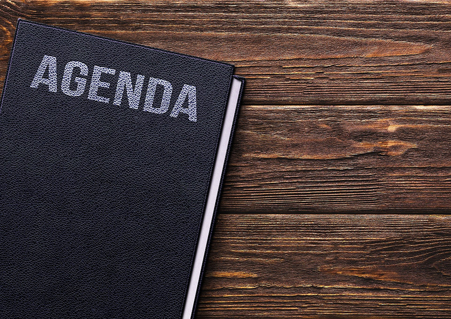 """An image of a book. The title reads """"Agenda""""."""