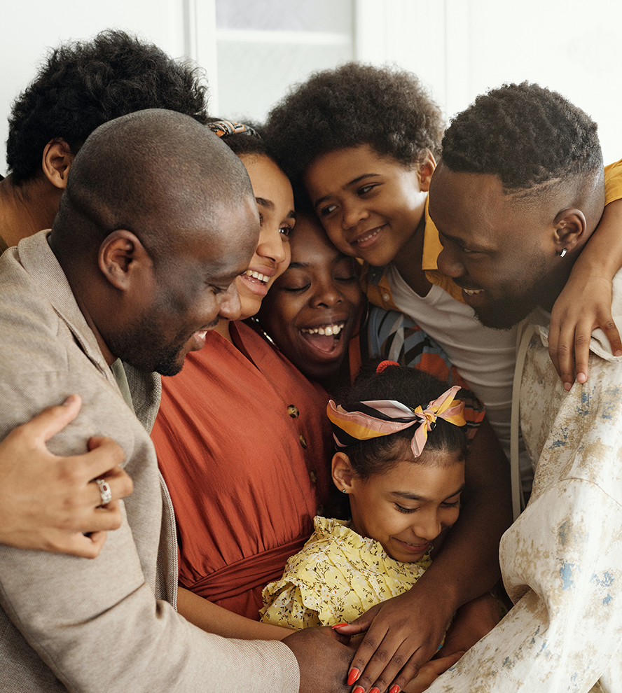 A smiling family hugging each other.